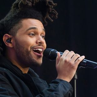 The Weeknd took the top two spots on the latest RS 100, and Christmas singles flooded the chart