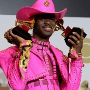 """When sharing an impeccable photo of Grammy winner Lil Nas X on Wednesday, Pastor Troy said he """"won't be winning a Grammy"""" if """"this what I gotta wear."""""""